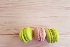 Macaron on a pink wooden biscuit sweet, view. Macaron on a pink wooden biscuit sweet view stock photography
