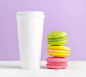 Macaron and tumbler of coffee Royalty Free Stock Images