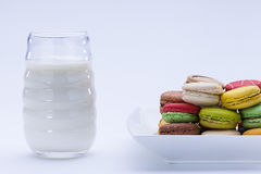 Macaron,white background, Candy, glass of milk. Close up shot of various kind of fresh macaroon arrangement with a glass of milk Stock Photography