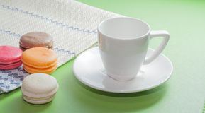 Macaron and white cup Stock Images