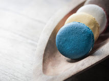 Macaron on wood bowl Royalty Free Stock Photography