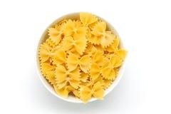 Macaroni. An image of a bowl of raw yellow macaroni Royalty Free Stock Images