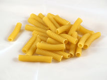 Macaroni. Some Italian macaroni (maccheroni) on white background stock photos