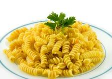 Macaroni... Fusilli and tomato sauce isolated over white Stock Images
