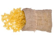 Macaroni in a bag. On a white background isolation Royalty Free Stock Image