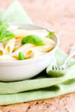 Macaroni and basil leafs Royalty Free Stock Images