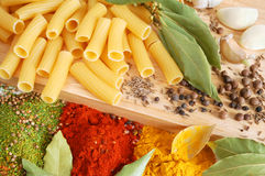 Macaroni with bay leaves and spice stock images