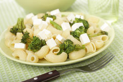 Macaroni with broccoli and feta cheese Stock Image