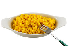 Bowl of Macaroni and Cheese Isolated. White dish filled with macaroni and cheese with a fork, isolated stock image