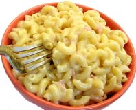 Macaroni and cheese. And fork in orange bowl Stock Photos