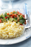 Macaroni and cheese with avocado salad Stock Photo
