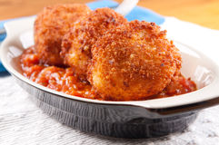 Macaroni and cheese balls with marinara sauce Royalty Free Stock Photography