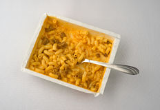 Macaroni and cheese with burger plus fork on table Stock Photo