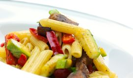 Macaroni. With cheese, chicken and mushrooms Royalty Free Stock Photo
