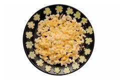 Macaroni cheese and cucumber Stock Photo