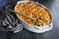 Macaroni and Cheese over Rustic Background Royalty Free Stock Image
