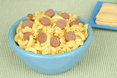 Macaroni and cheese with sliced hotdogs Stock Photos