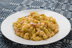 Macaroni and cheese on table Stock Image