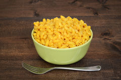 Macaroni and cheese on wood table Stock Images