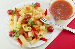 Macaroni with cherry tomatoes, parsley and red pepper served wit Royalty Free Stock Photography
