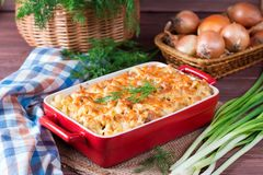 Macaroni, Chicken and Cheese Pasta Bake in a Ceramic Dish. Homemade cheesy pasta Royalty Free Stock Photography