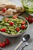Macaroni with chopped parsley Stock Photo