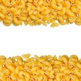 Macaroni closeup with copy space. Macaroni angle pasta closeup with copy space and clipping path on white background Royalty Free Stock Photos