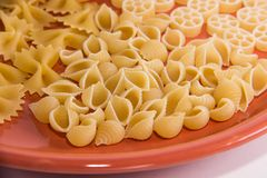 Varied macaroni on a plate macro stock photo