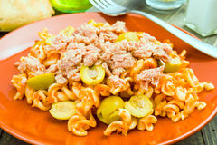 Macaroni dish cooked with olives and tuna, in rustic wooden Royalty Free Stock Images