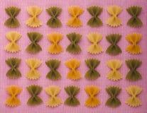 Macaroni farfalle colored. Three colors. Stock Image