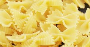 Macaroni Farfalle in massa stock footage