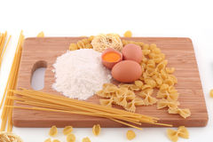 Macaroni, flour and eggs Royalty Free Stock Photo