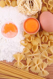 Macaroni, flour and eggs Royalty Free Stock Photos
