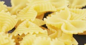 Macaroni Farfalle in bulk. Macaroni in the form of butterflies from durum wheat stock footage