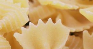 Macaroni Farfalle in bulk. Macaroni in the form of butterflies from durum wheat stock video