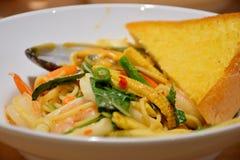 Macaroni, Fried Sea Bass, Delicious Menu. Macaroni with fried sea squash, mussels eaten Royalty Free Stock Photo
