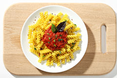 Free Macaroni Fusilli With Tomatoes Sauce In White Ceramic Plate On Wooden Cutting Board. Stock Photos - 72982023