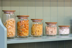Macaroni in glass containers Stock Images