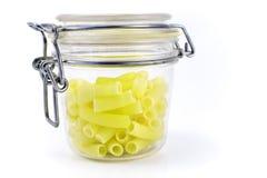 Macaroni in glass jar Stock Image