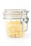 Macaroni in glass jar Stock Image