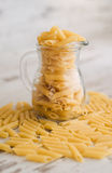 Macaroni in a glass jar Stock Image