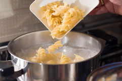 Macaroni italian food pasta. Cooking some of good pasta in the kitchen Stock Image