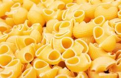 Macaroni italian pasta background Royalty Free Stock Image