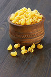 Macaroni italian pasta in wood bowl Stock Images