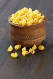Macaroni italian pasta in wood bowl Stock Images
