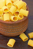 Macaroni italian pasta in wood bowl Royalty Free Stock Photo