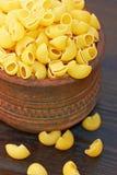 Macaroni italian pasta in wood bowl Stock Photo