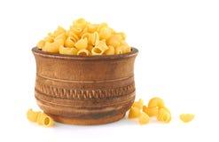 Macaroni italian pasta in wood bowl Royalty Free Stock Photos