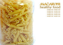 Macaroni jar full of glass Royalty Free Stock Photo