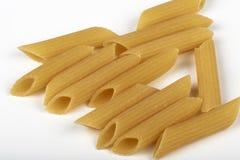 Macaroni kamut. Some kamut wheat macaroni on white background Stock Images